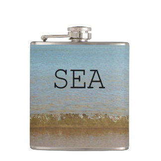 Bright Blue Sea and a gentle wave. Hip Flask