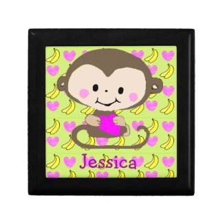 Bright colored cartoon monkey holding heart gift boxes
