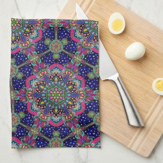 Bright colorful mandala pattern on dark blue kitchen towel