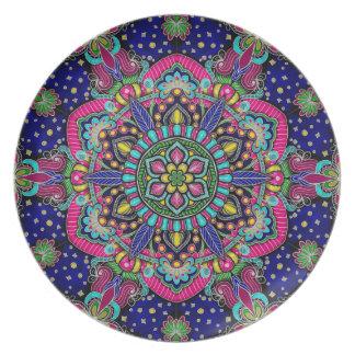 Bright colorful mandala pattern on dark blue plate