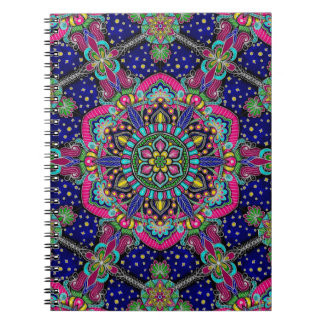 Bright colorful mandala pattern on dark blue. spiral notebook