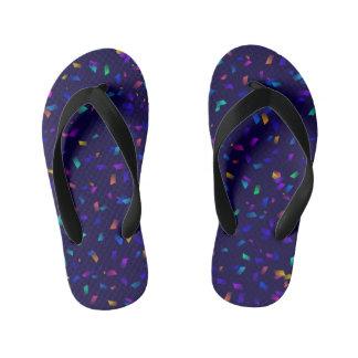 Bright colorful neon confetti on dark kid's flip flops