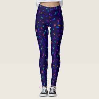 Bright colorful neon confetti on dark leggings
