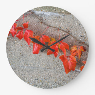 Bright coloured autumn leaves wall clock