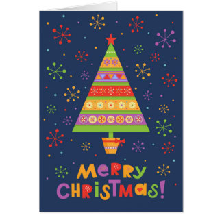 Bright fir tree in a pot with bow-knot card