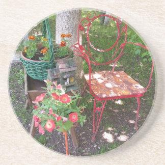 Bright orange garden chair beverage coasters