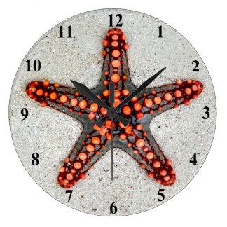 Bright Orange Red Starfish on White Sand Large Clock
