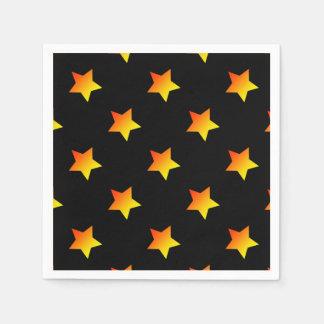 Bright orange star on black. napkin