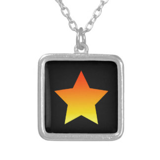 Bright orange star on black. silver plated necklace