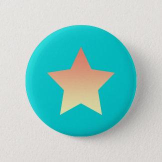Bright orange star on blue. 2 inch round button