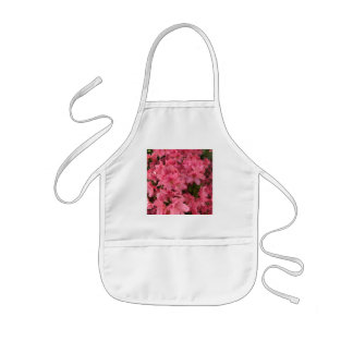 Bright pink flowering bush in the spring kids apron