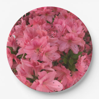 Bright pink flowering bush in the spring paper plate