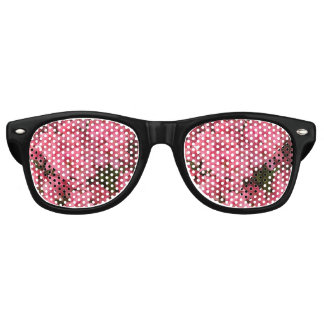 Bright pink flowering bush in the spring retro sunglasses