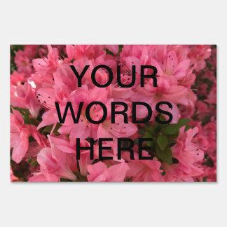 Bright pink flowering bush sign