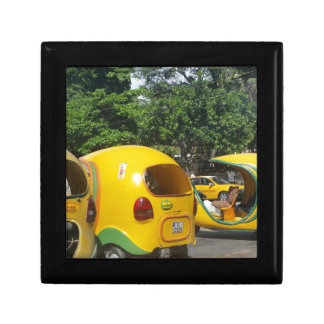 Bright yellow fun coco taxis from Cuba Gift Box