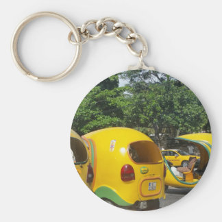 Bright yellow fun coco taxis from Cuba Keychain
