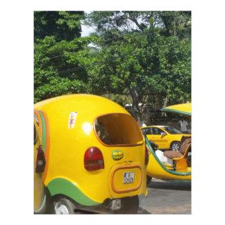 Bright yellow fun coco taxis from Cuba Letterhead