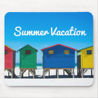 Brightly painted beach huts with blue sky mouse pad