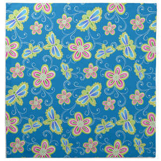 Brillant flowers, dragonflies and swirls on blue napkin