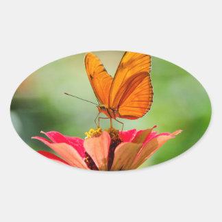Brilliant Butterfly on Bright Orange Gerber Daisy Oval Sticker
