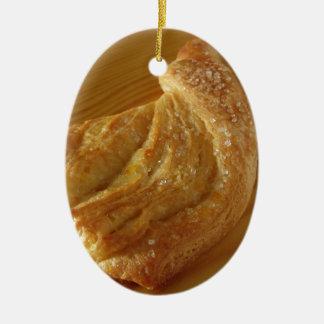 Brioche on a wooden table ceramic ornament
