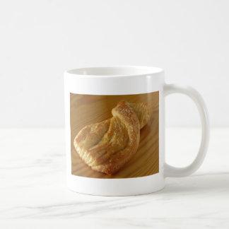 Brioche on a wooden table coffee mug