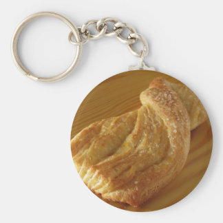 Brioche on a wooden table keychain