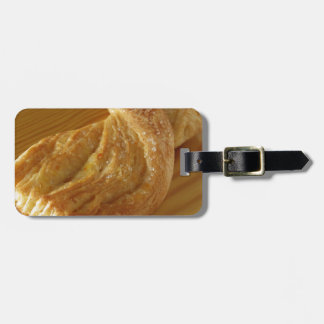 Brioche on a wooden table luggage tag