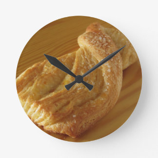 Brioche on a wooden table round clock