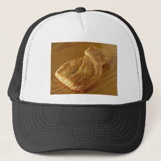 Brioche on a wooden table trucker hat