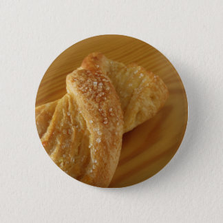 Brioche on a wooden table with granulated sugar 2 inch round button