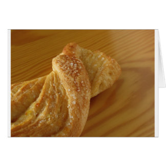 Brioche on a wooden table with granulated sugar card