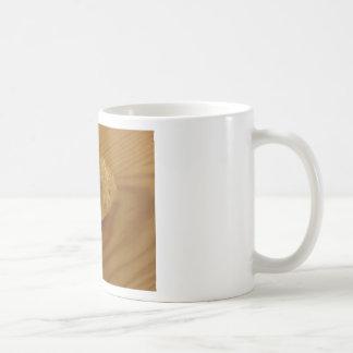 Brioche on a wooden table with granulated sugar coffee mug