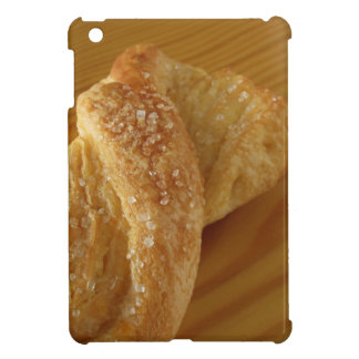 Brioche on a wooden table with granulated sugar iPad mini case