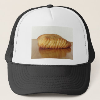 Brioche on a wooden table with granulated sugar trucker hat