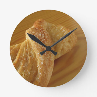 Brioche on a wooden table with granulated sugar wallclock
