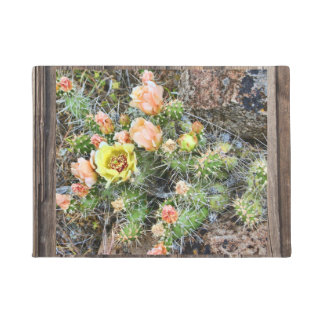 BRITTLE PRICKLY-PEAR CACTUS ON WOOD DOORMAT