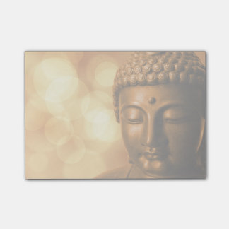 Bronze Buddha Statue with Golden Bokeh Background Post-it Notes