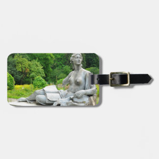 Bronze statue depicting woman luggage tag