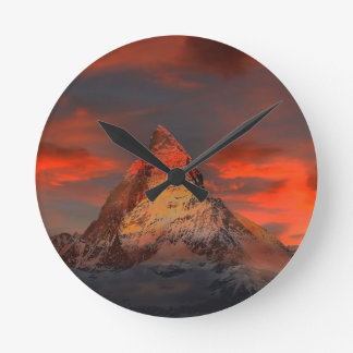 Brown and Gray White Mountain Under Cloudy Sky Round Clock