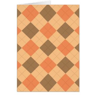 Brown and orange argyle pattern card