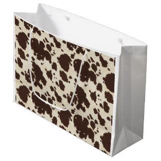 Brown and white cowprint bag