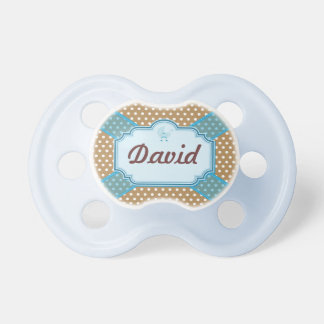 Brown and white dotted with you lasso baby pacifiers
