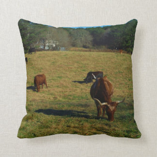 Brown and white longhorn cattle throw pillow