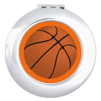 Brown Basketball Ball on Orange Travel Mirrors