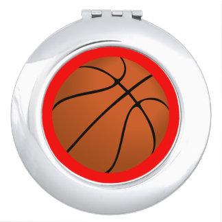 Brown Basketball Ball on Red Makeup Mirror