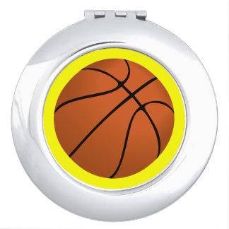Brown Basketball Ball on Yellow Makeup Mirror