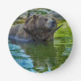 Brown bear in water wallclocks