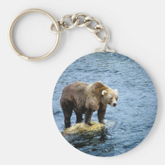 Brown bear on rock in river keychain