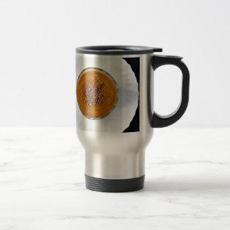 brown chocolate avocado smoothie with white plate travel mug